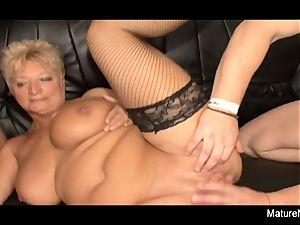 Mature blondie needs two weenies to be pleased