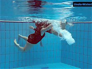 two torrid teenagers underwater