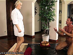 busy blond getting a Nuru massage
