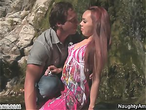 Exotic pornography with a red-haired suntanned latina near a waterfall