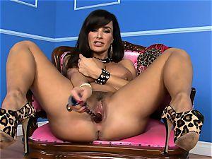 mind-blowing Lisa Ann stuffs her dildo deep in her raw vag