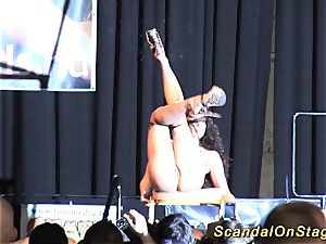 big-boobed flexible stripper on stage
