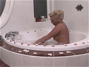 hot Ginger Jones soaps herself up