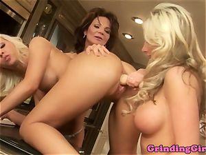 Glam lezzies belt cock ass fucking in kitchen