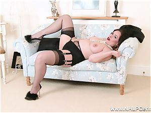 dark-haired in lingerie opens up nylon gams fingers pussy