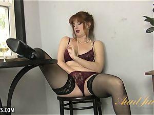 Amber Dawn elations herself wearing thigh highs.