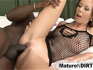 black-haired milf drains before taking a bbc