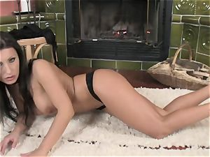 bombshell Nikki Rider alone and naughty in front of the fire